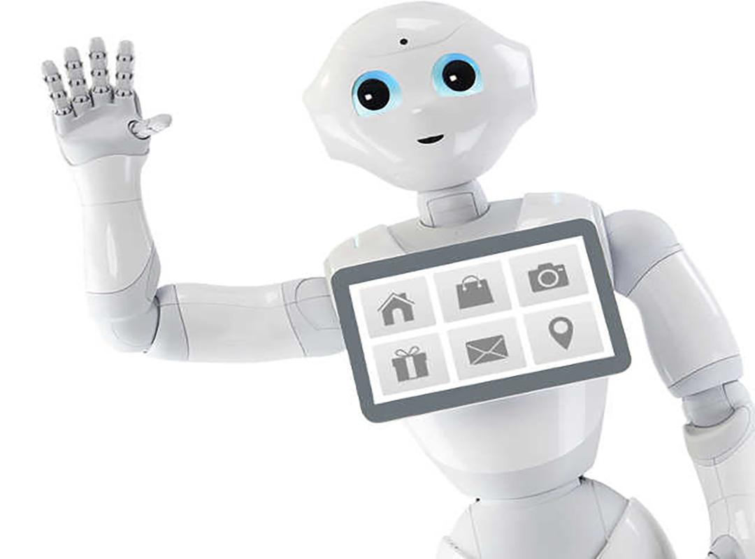 Mesterséges intelligencia segítségével működő humanoid robot integet a képen. A mellkasán tablet van elhelyezve.