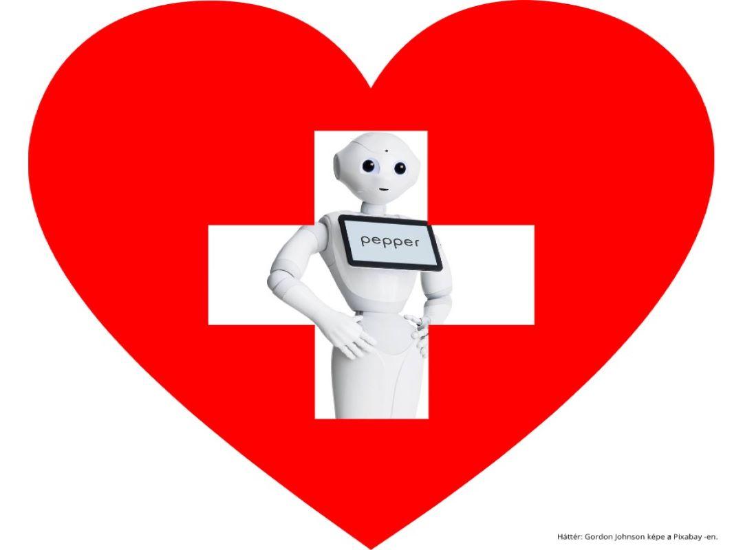 Pepper kórházi robot assztisztens egy kórházi szív embléma mögött áll.