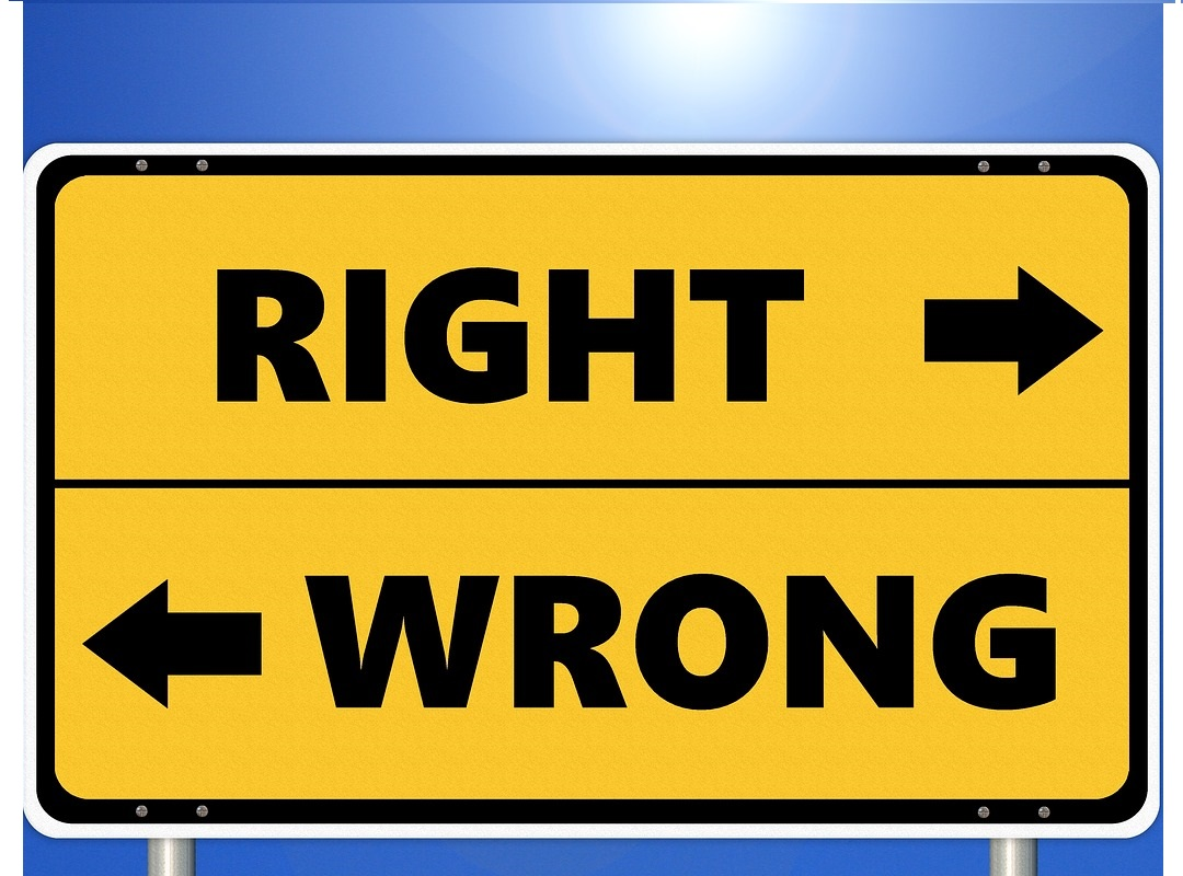"""Right and wrong directions on a table. Illustration for blog """"Artificial intelligence ad ethics."""