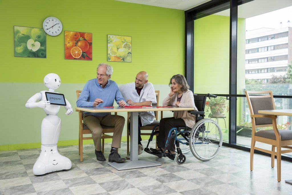 E-healthcare solution: Pepper robot with patients and a nurse in a German hospital